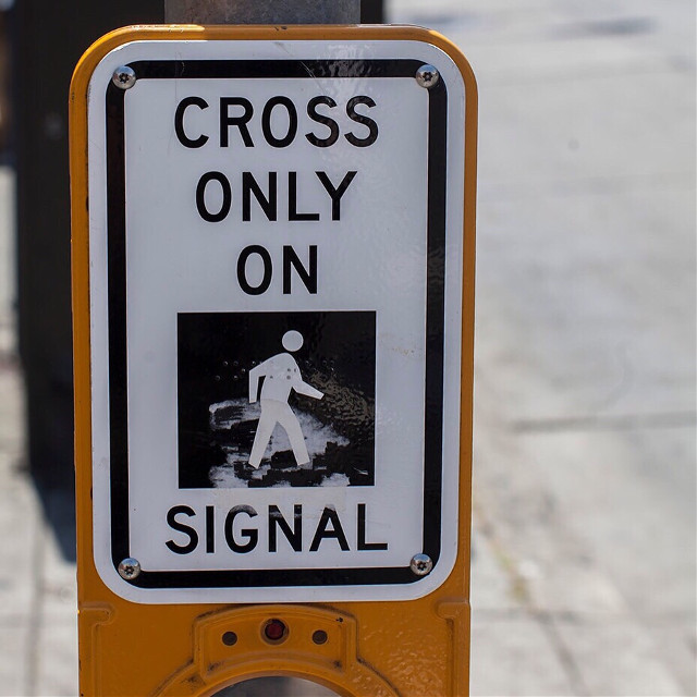 Cross Only On Signal. Everyday on my way to the office, to a restaurant, to the gym, a cappuccino stop, I see #pedestrians not heeding this sign and just adding to the chaos in the #urban environment. I know how tempting it is to walk against the red and to simply not pay attention. Before I became a consistent pedestrian, I was not as careful either (as a pedestrian or a driver). Now that I witness close calls on a weekly basis, I take all moving things on the street seriously. The lessons of my first year in San Francisco FiDi have taught me well. But there are no guarantees, we have to be smart and lucky. (August 8, 2014, San Francisco, CA) #pedestrians #traffic #crosswalks #safety #autos #automobiles #sanfrancisco #sanfranciscofidi #streetlife